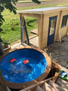 Fiberglass lined hot tub with integrated burner thermo wood Wellness Royal
