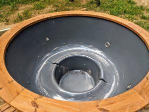 Fiberglass outdoor hot tub with external heater 21