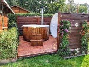 Fiberglass lined hot tub with integrated burner thermo wood Wellness Royal 1 3