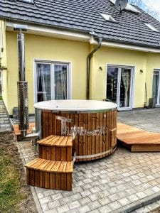 Fiberglass lined hot tub with integrated burner thermo wood Wellness Royal 2 6