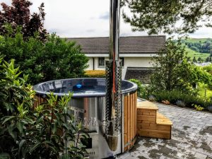 Fiberglass lined hot tub with integrated burner thermo wood Wellness Royal 2 8