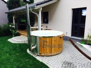 Fiberglass lined hot tub with integrated burner thermo wood Wellness Royal 3 2