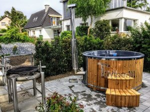 Fiberglass lined hot tub with integrated burner thermo wood Wellness Royal 4 4