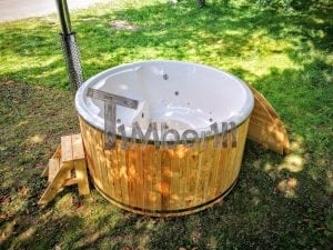 Outdoor fiberglass hot tub with integrated heater Wellness Deluxe 12