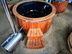 Outdoor hot tub with wood fired external burner black fiberglass thermo wood 11