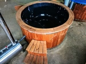 Outdoor hot tub with wood fired external burner black fiberglass thermo wood 3