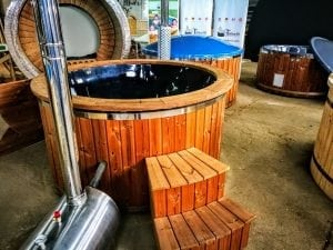 Outdoor hot tub with wood fired external burner black fiberglass thermo wood 8