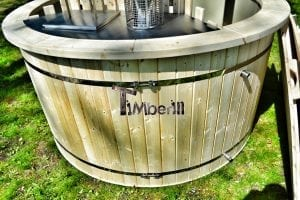 Wood fired hot tub for garden. Includes sand filtration 2 LED and wall insulation 4