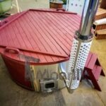 Fiberglass lined outdoor hot tub integrated heater with wood staining in red 30