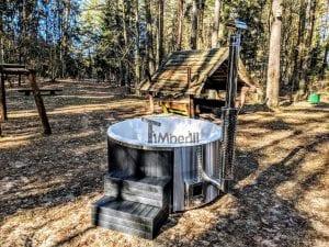 Black fiberglass lined hot tub with integrated burner Wellness Scandinavian 1
