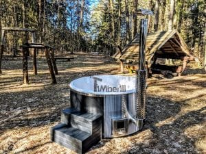 Black fiberglass lined hot tub with integrated burner Wellness Scandinavian 2