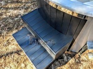 Black fiberglass lined hot tub with integrated burner Wellness Scandinavian 24