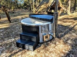 Black fiberglass lined hot tub with integrated burner Wellness Scandinavian 34