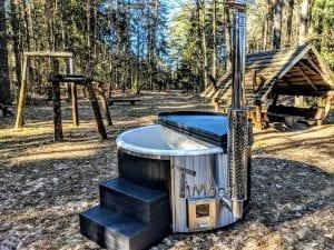 Black fiberglass lined hot tub with integrated burner Wellness Scandinavian 36