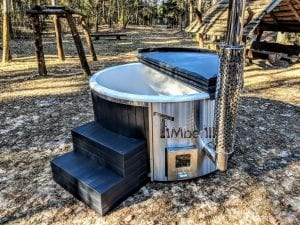 Black fiberglass lined hot tub with integrated burner Wellness Scandinavian 40