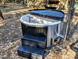 Black fiberglass lined hot tub with integrated burner Wellness Scandinavian 41