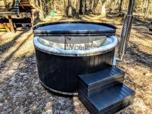 Black fiberglass lined hot tub with integrated burner Wellness Scandinavian 44